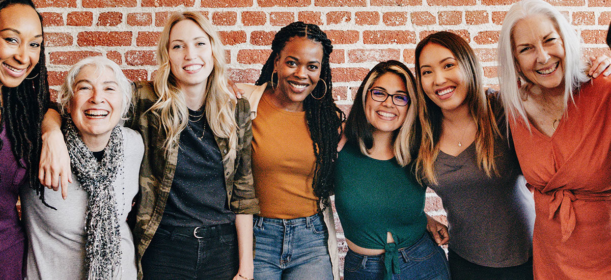 diverse row of woman smiling