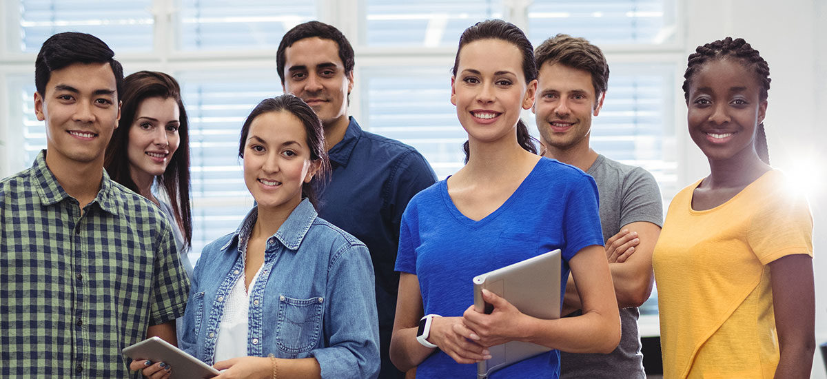 Group of diverse men and women smiling in an office