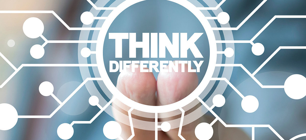 "Fingers touching a display that says ""think differently"""